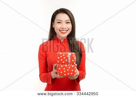 Beautiful Woman In Red Ao Dai Dress Holding Gift Box