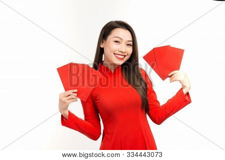 Asian Girl In Traditional Dress And Take Red Envelopes Lunar New Year, Tet Holiday Concept