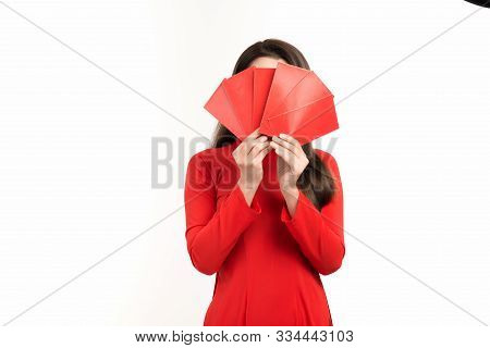Pretty Asian Woman Wearing Red Ao Dai And Holding Red Envelope For Lunar New Year.