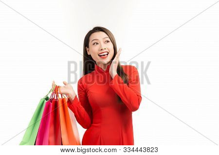 Asian Lady In Red Ao Dai Dress Holding Shopping Bags Isolated On White Background, Happy Lunar New Y