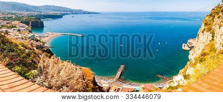 Panorama Of High Cliffs, Tyrrhenian Sea Bay With Pure Azure Water, Floating Boats And Ships, Pebble