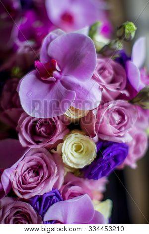 bridal bouquet of purple orchids
