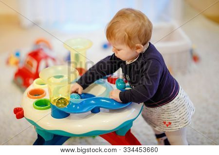 Adorable Cute Beautiful Little Baby Girl Playing With Educational Sorter Toys At Home Or Nursery. He