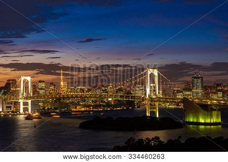 Aerial view of Tokyo skylines with Rainbow bridge and tokyo tower over Tokyo bay Sunset Twilight from Odaiba in Tokyo city Kanto Japan.