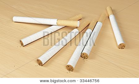 many cigarette on the wooden background