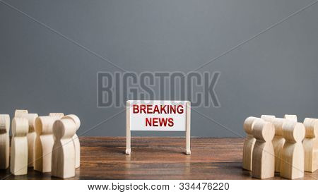 People Surrounded A Whiteboard With The Words Breaking News. Important Events And Incidents, Extraor