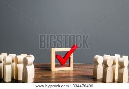 People Look At The Vot Checkmark. Voting In The Elections. Democratic Institutions Process, Poll And