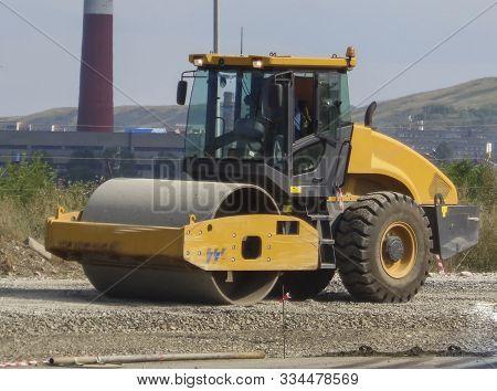 Steamroller Performing Leveling Work On A Road Under Construction. Ust-kamenogorsk (kazakhstan)