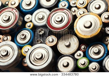 Dumped used Alkaline batteries of various types (C AA AAA D 9V) ready for recycling - toxic waste and environmental issues concept