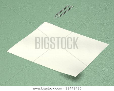 Note Paper With Paper Clip On Green Background