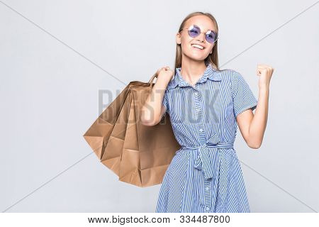 Happy Shopping Woman With Win Gesture Excited And Cheerful In Joyful Bliss With Shopping Bags Isolat