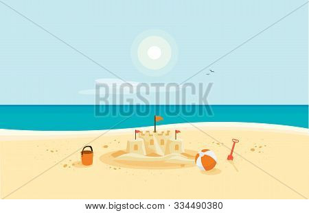 Lonely Sand Castle On Sandy Beach With Blue Sea Ocean Water And Coast Line Clear Summer Sunny Sky In