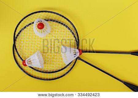 Badminton. Three Shuttlecocks And Two Badminton Rackets.