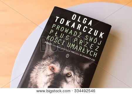 Warsaw, Poland - October 28, 2019: Novel By Polish Writer Olga Tokarczuk On A Coffee Table. Olga Tok