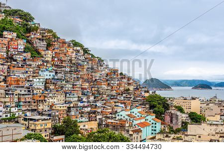 Brazilian Favelas On The Hill With City Downtown Below At The Tropical Bay, Rio De Janeiro, Brazil