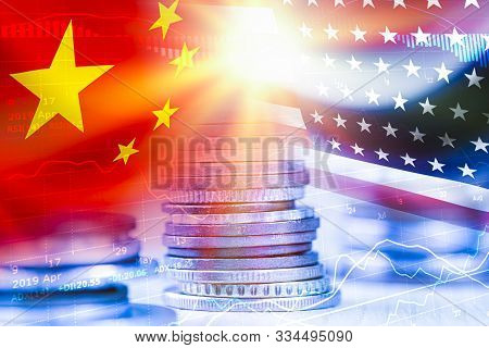Usa And China Flag On Coins Stacking .it Is Symbol Of Economic Tariffs Trade War And Tax Barrier Bet