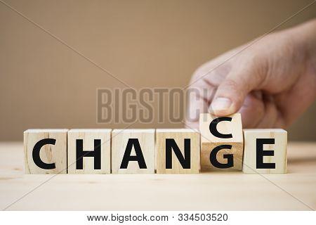 Hand Flipping Wooden Cubes For Change Wording Between