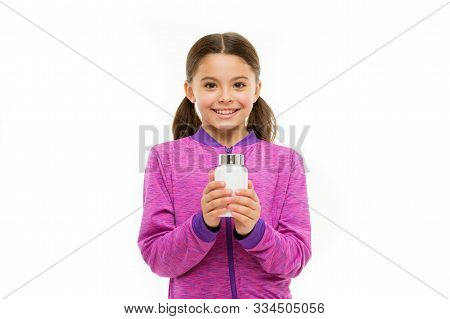 This Is Healthy Life. Little Girl Happy Smile. Small Child Isolated On White. Pills For Healthy Grow