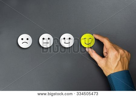 Conceptual The Customer Responded To The Survey. The Client Using Hand Choose Happy Face Smile Icon.
