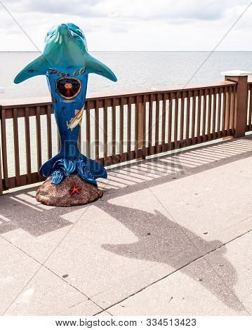Clearwater Beach, Florida, Usa 11/6/19 A Dolphin Statue On Pier 60 Overlooking The Gulf Of Mexico On