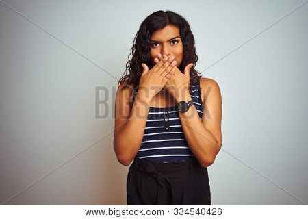 Transsexual transgender woman wearing striped t-shirt over isolated white background shocked covering mouth with hands for mistake. Secret concept.