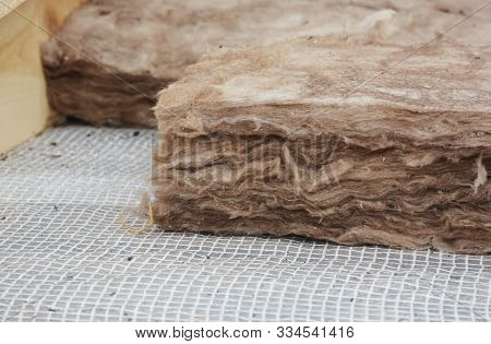 Roof Insulation. Close Up On Insulation Layers Of Mineral Wool Insulation, House Roof Insulation.