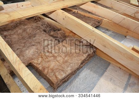 Attic Roof Insulation. Close Up On Insulation Layers Of Mineral Wool Insulation, House Roof Insulati
