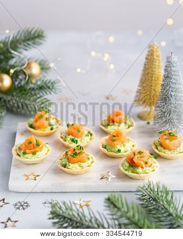 Canapes With Smoked Salmon, Cream Cheese And Avocado On Light Background With Copy Space. Christmas