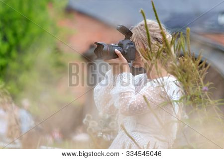 Saint Petersburg, Russia - August 19, 2019: Female Photographer Taking Photos In The Park In Summer