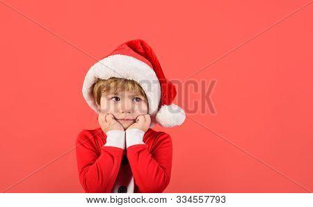 Merry Christmas. Little Boy In Santa Claus Hat. Christmas Time. Santa Helper. Happy New Year. Little