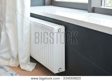 White Radiator Heating With In Modern House Bedroom