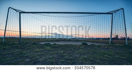 Soccer Goal In The Sunset With Blue Sky And Meadow