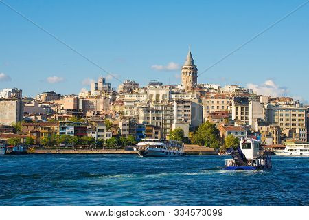 Boats Ferry Commuters And Tourists To And From The Beyoglu Waterfront. Viewed From Galata Bridge Wit