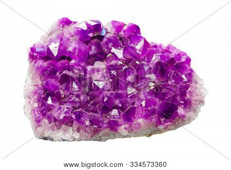 Violet Crystal Stone macro mineral. Purple rough Amethyst quartz crystals geode isolated on white. Amethyst gemstone Crystal Druse macro quartz mineral close up. Stone part of amethyst rock