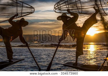 Nyaungshwe Township, Myanmar (burma). January 11, 2019: Intha Fishermen Posing With Conical Nets At