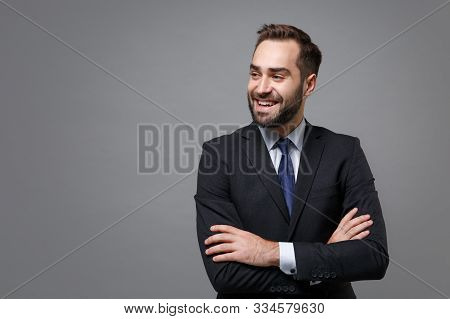 Smiling Young Business Man In Classic Black Suit Shirt Tie Posing Isolated On Grey Background. Achie