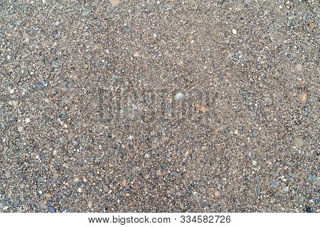 The Texture Of Fine Gravel. Colorful River Pebbles Wet From Rain. Background For Creativity.