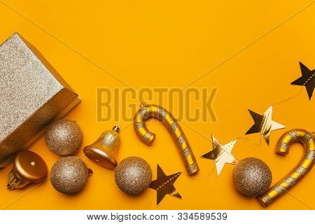 Golden Christmas Decorations: Balls, Bells, Lollipops And Gift On A Yellow Background. Festive Mood,