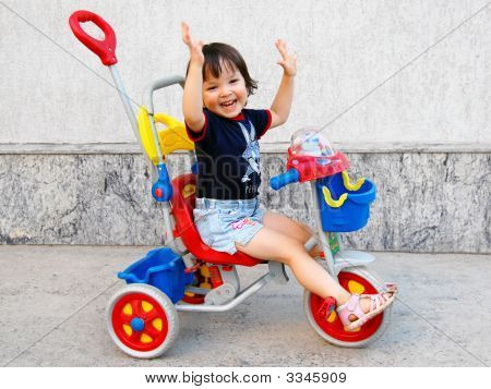 Baby On Tricycle