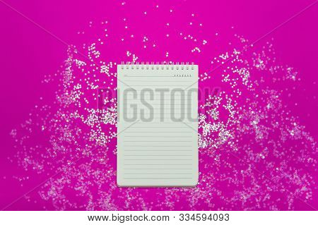 White Notebook On A Neon Pink Background With Sparkles. Christmas , Festive Mood, Luxury Party, Wint