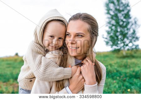 Little Boy Hugs Mom Happy Smiling, Tenderness Care Son, Autumn Day Warm Clothes With Hood, Woman Mom