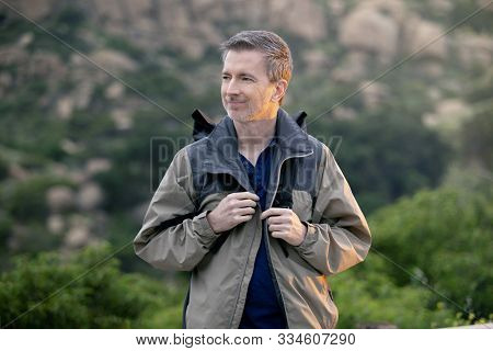 Middle Aged Man Staying Healthy By Doing Outdoor Activities During A Nature Getaway Vacation.  He Is