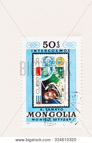 Seattle Washington - October 5, 2019: 1981 Mongolia Stamp Featuring  Former Cuban Postage Stamp Comm
