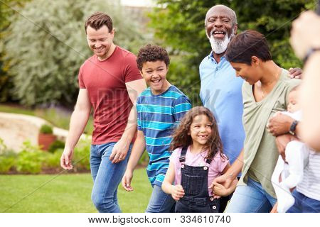 Smiling Multi-Generation Mixed Race Family In Garden At Home Together