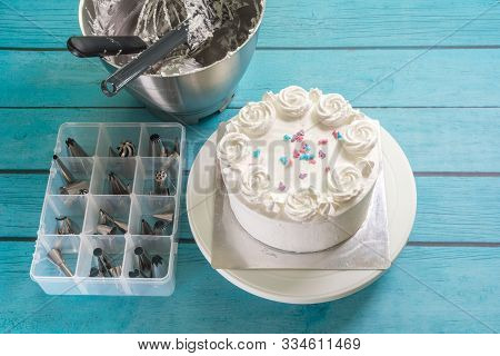 Cake Frosting Making Baking Mixer Bowl, And Box Of Piping Nozzles On Kitchen Table
