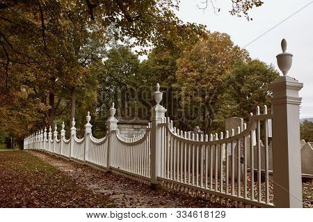Bennington, Vermont - October 1st, 2019:  Historic Cemetery Behind A White Picket Fence In The New E