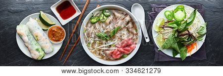 vietnamese beef pho with spring rolls in flat lay composition