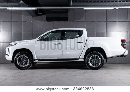 Novosibirsk, Russia - October 05, 2019:  New White Mitsubishi L200, Side View.  Photography Of A Mod