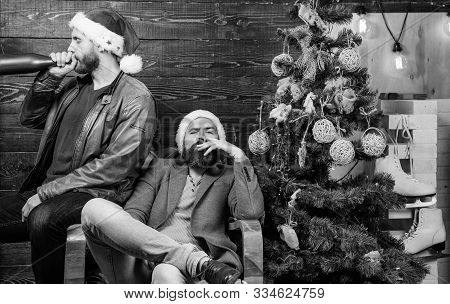 Brutal Men Celebrate New Year Near Christmas Tree. New Years Resolution. Bad Habits To Kick Before T