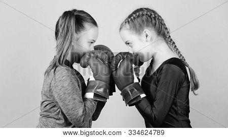 Female Friendship. Girls In Boxing Sport. Boxer Children In Boxing Gloves. Girls Cute Boxers On Blue